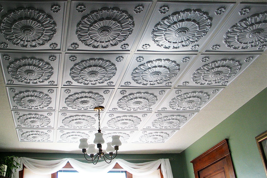 i installed the medallion tiles and for the perimeter i used a textured wall paper right over the old primed drop ceiling tiles